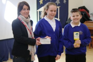 Our Head Boy  and Girl present the cheque